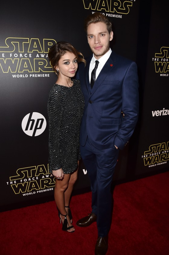 """HOLLYWOOD, CA - DECEMBER 14:  Actors Sarah Hyland (L) and Dominic Sherwood attend the World Premiere of """"Star Wars: The Force Awakens"""" at the Dolby, El Capitan, and TCL Theatres on December 14, 2015 in Hollywood, California.  (Photo by Kevin Winter/Getty Images for Disney) *** Local Caption *** Sarah Hyland;Dominic Sherwood"""