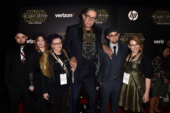 """HOLLYWOOD, CA - DECEMBER 14:  Actor Peter Mayhew (C) and family attend the World Premiere of """"Star Wars: The Force Awakens"""" at the Dolby, El Capitan, and TCL Theatres on December 14, 2015 in Hollywood, California.  (Photo by Kevin Winter/Getty Images for Disney) *** Local Caption *** Peter Mayhew"""