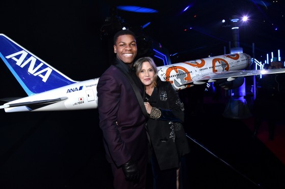 """HOLLYWOOD, CA - DECEMBER 14:  Actors John Boyega (L) and Carrie Fisher attend the World Premiere of """"Star Wars: The Force Awakens"""" at the Dolby, El Capitan, and TCL Theatres on December 14, 2015 in Hollywood, California.  (Photo by Mike Windle/Getty Images for Disney) *** Local Caption *** John Boyega;Carrie Fisher"""